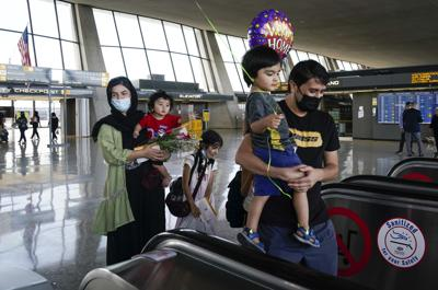 News: Afghan refugees arrive at Dulles International Airport