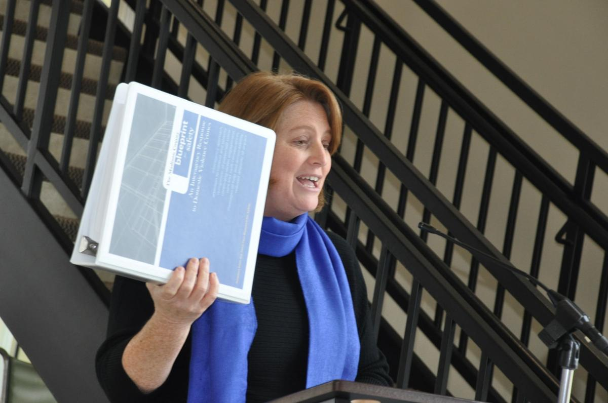Following the blueprint madison county launches domestic violence hopes wings director jennifer lainhart holds up a copy of the blueprint agencies in madison county have signed on to follow when handling domestic violence malvernweather Choice Image