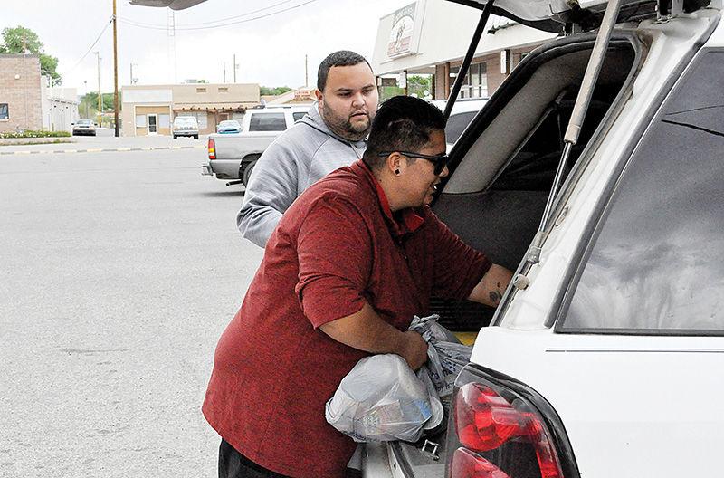 Monica Velasquez handing out food