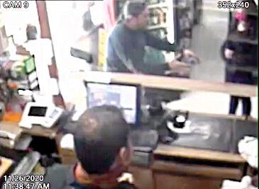 Tim Lopez explaining shooting to a customer