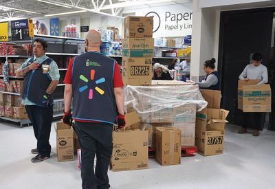 coronavirus walmart workers hand out tissue