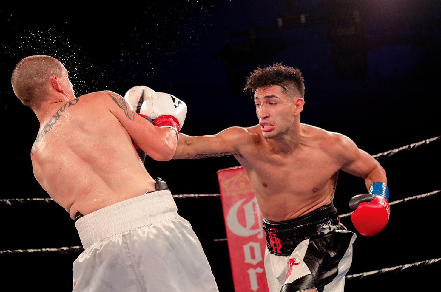 Brandon Holmes punches Gene Perez