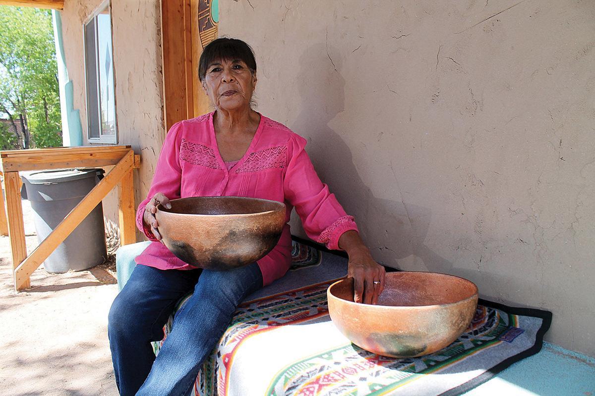 Marian Naranjo with pots 7-15-19.jpg