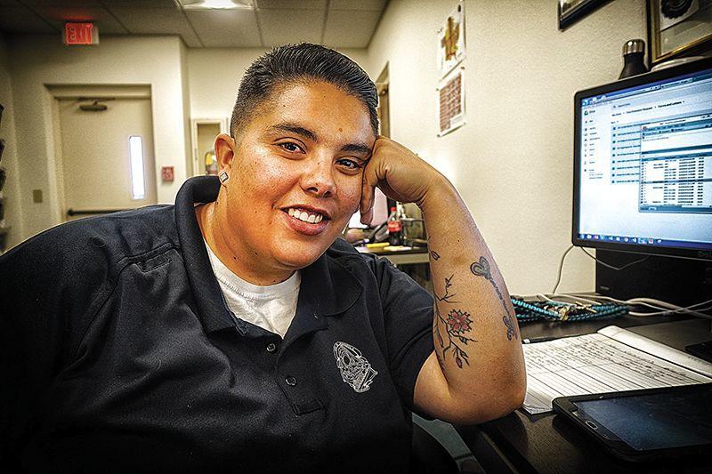 Monica Velasquez portrait at desk