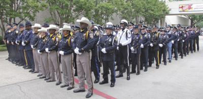Thousands mourn for Dallas police officer at memorial | News
