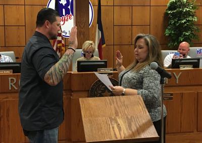 Holder taking oath