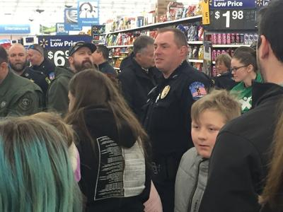 40 local students get police escort to holiday giving