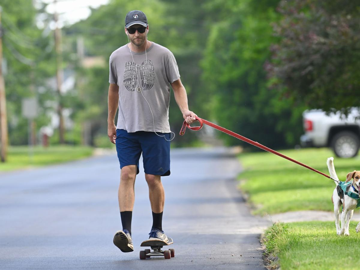 A dog and his skateboarder