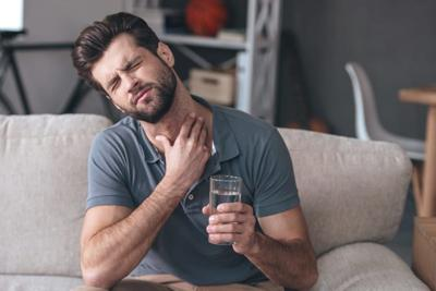 What Doctors Think About Gargling With Salt Water When You Have A Sore Throat