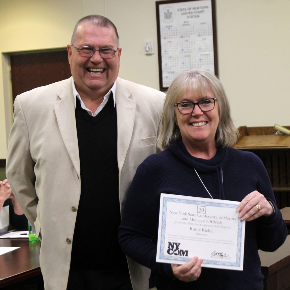 Riehle, Bocharski recognized for 55 years combined service to city Ruthe
