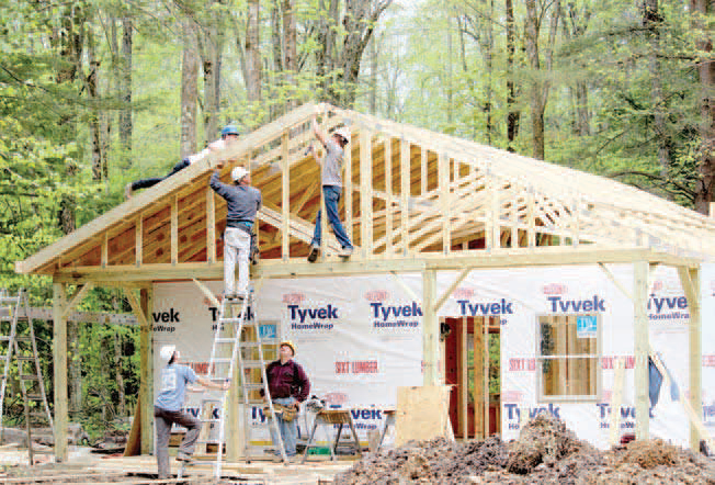A Construction Crew Works On One Of 14 Upscale Cabins Being Built On  Parallel Trail On The Quaker Side Of Allegany State Park. Another 14 Cabins  Will Be ...