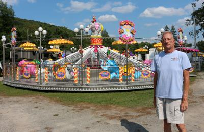 Midway rides being assembled at Cattaraugus County Fairgrounds