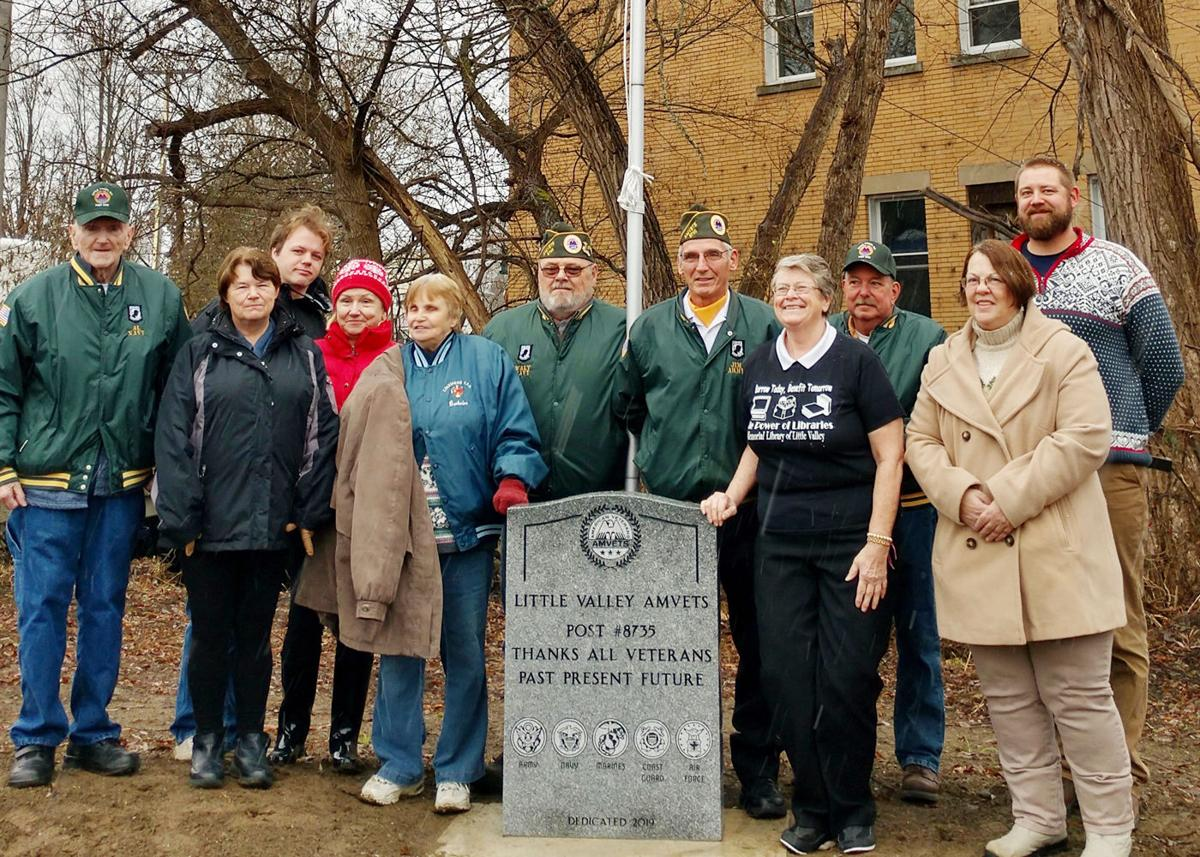 Flagpole, monument dedicated at Little Valley library open house outside