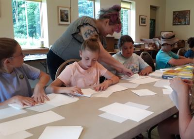 Trying bookbinding at the Ellicottville library