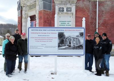 C.A.M.P. erects new sign at Memorial Building