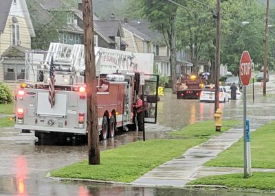 Academy Street flooding strands car