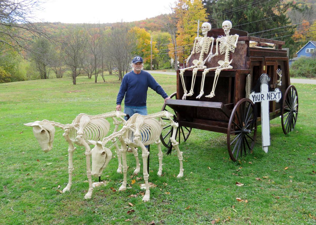 Ghouls, ghosts and goblins lurk in State Park Avenue Halloween display stagecoach