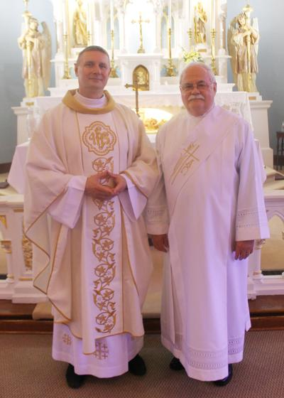Our Lady of Peace priest and deacon