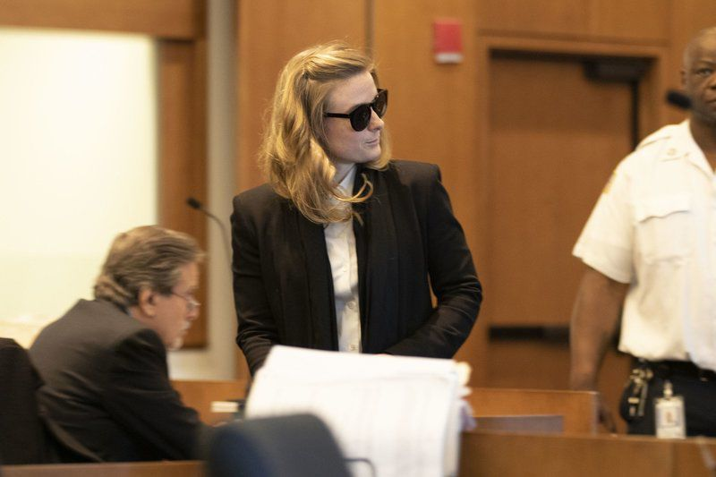 Gloucester woman quietly slips into court for arraignment in road rage