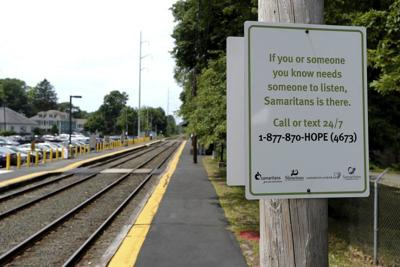 Signs aim to stop suicide by train