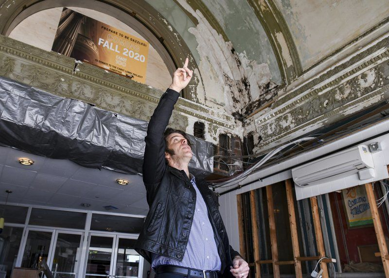 Hey presto Lobby renovation reveals historic theater'sarched ceilings