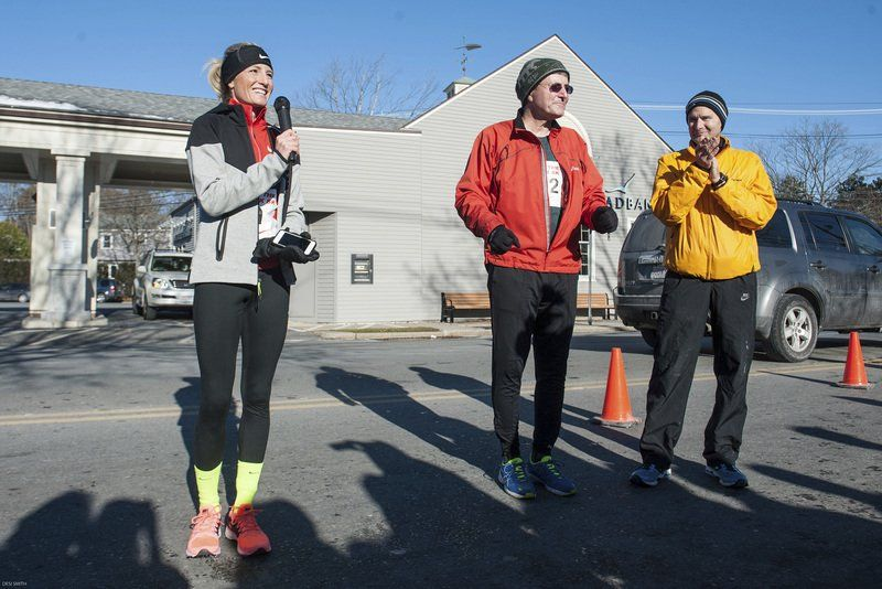 Marblehead native and three-time Olympian Shalane Flanagan speaks to a large crowd outside the Marblehead Community Center Saturday morning, Nov. 29. Flanagan, with the help from her dad, Steve, (center) returned home to run in, and help organize, the Back The Track 5K to help raise funds for track at the Village School in Marblehead.