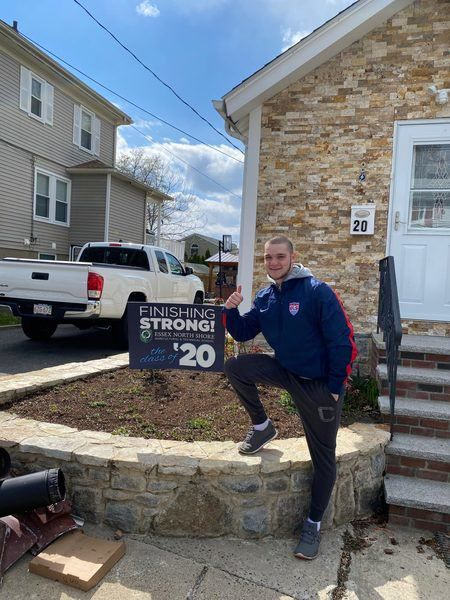 Essex Tech educators deliver signs to homes of school seniors