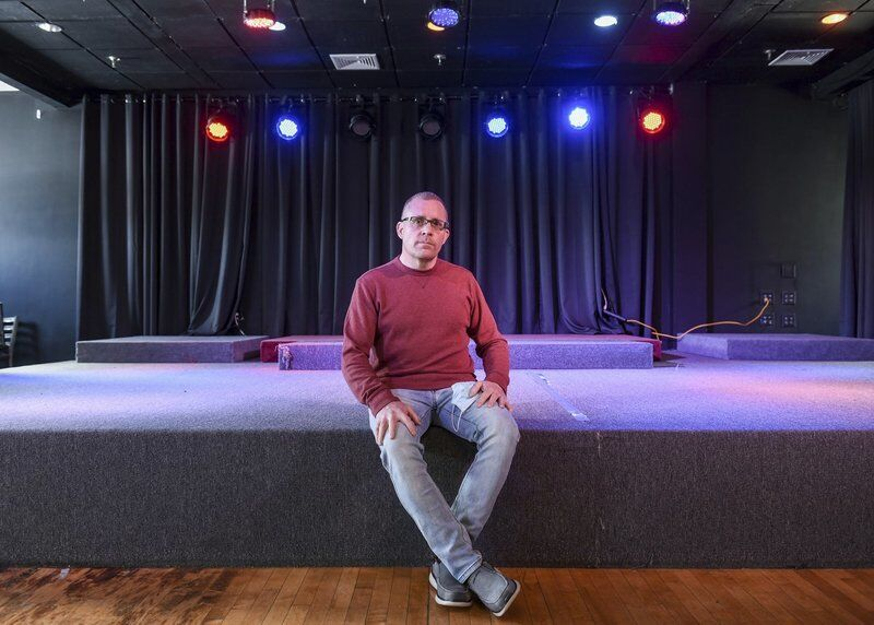 Owner of venue hangs on-- with help from radio personality