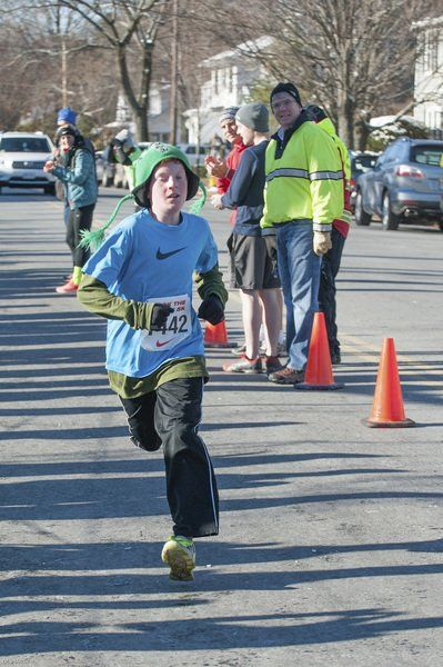 Nate May, 11, of Marblehead heads to the finish line placing first in the kids 1-mile run outside the Marblehead Community Center.