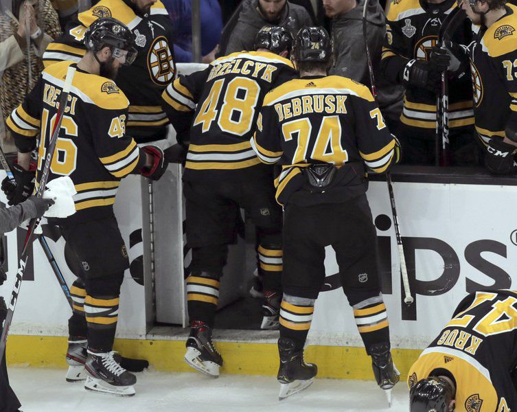 Phil Stacey column: Loss of Grzelcyk--and Game 2--will force Bruins to reshuffle their deck defensively