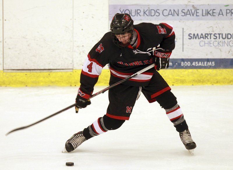 Marblehead senior center Cam McDonald (4) fires a slap shot on net against Beverly on Saturday evening.
