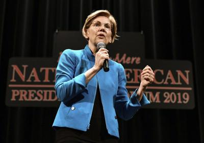 Warren apologizes for heritage claim, woos Native Americans