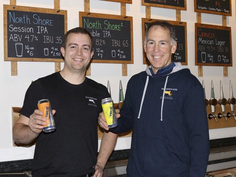 Jake and Gary Rogers with award-winning beers