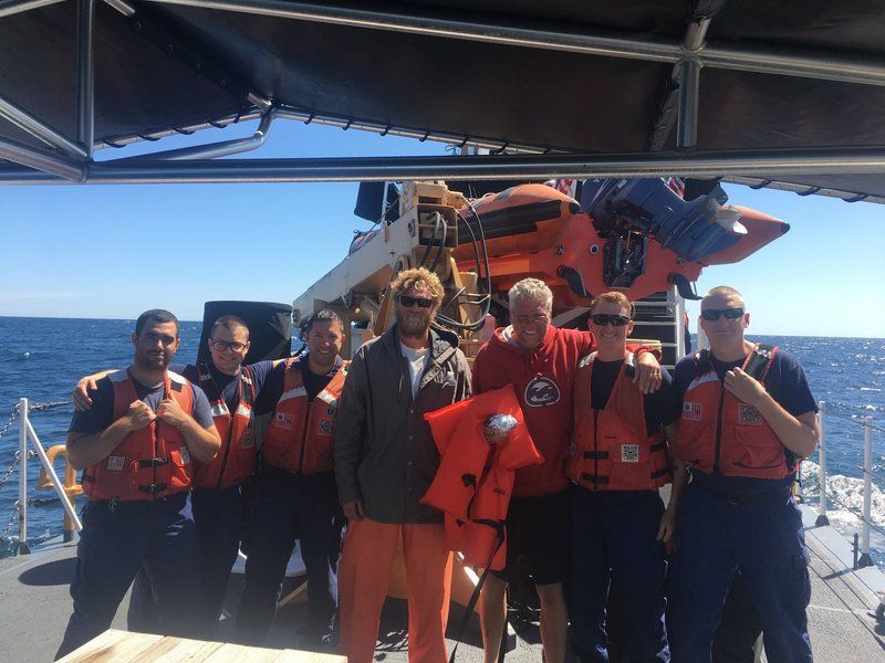 Coast Guard brings rescued boaters to Gloucester