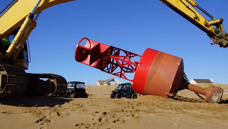 Marooned buoy removed from beach