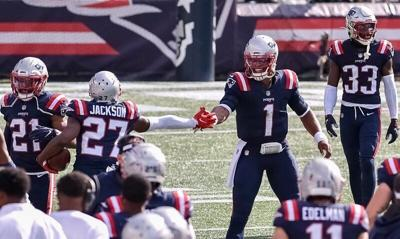 Total team effort by secondary as Patriots smother Dolphins