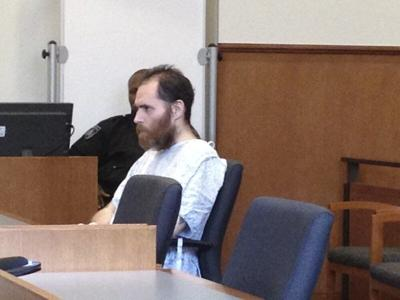 Accused robber asks for dismissal due to long-delayed trials