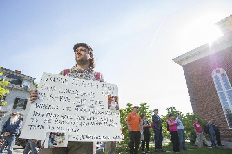 Crowd rallies against judge's decision
