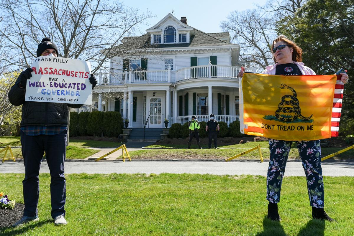 Protesters gather outside Gov. Charlie Baker's home in Swampscott