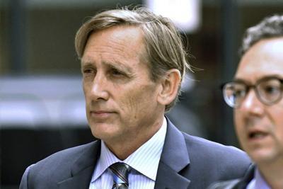 Ex-surfing exec sentencedin college admissions scandal