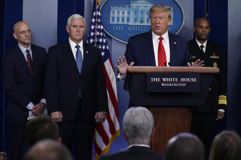 Trump angrily defends his handling of pandemic