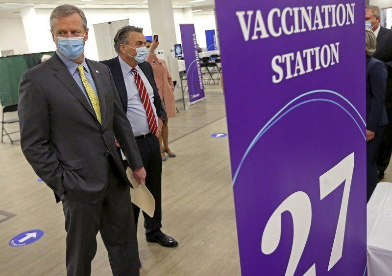 Baker grilled over slow COVID-19 vaccine rollout