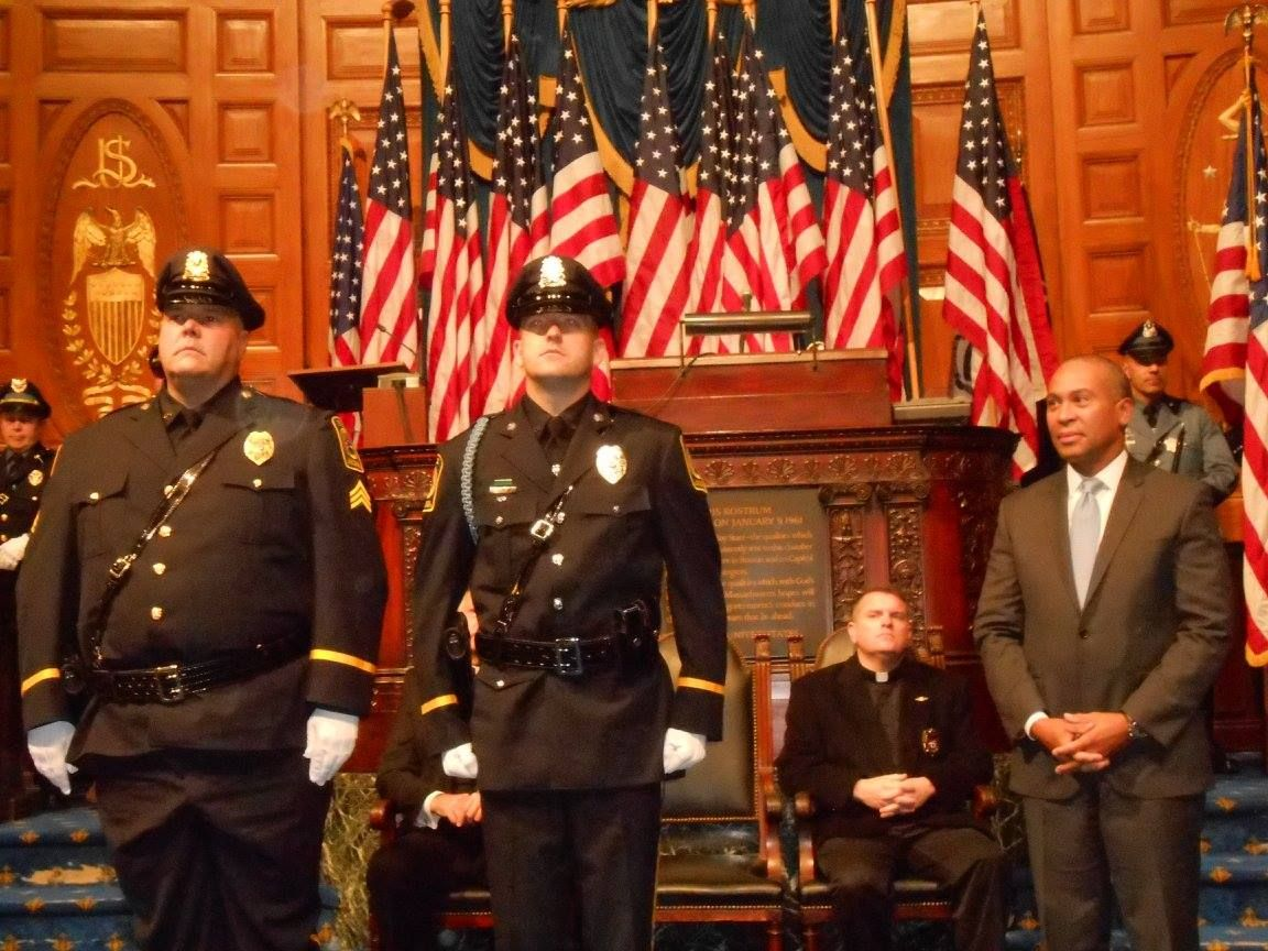 Danvers Police Sgt. Peter Shabowich, far left, and officer Justin Ellenton, second from left, receive the George Hanna Medal of Valor Wednesday, Nov. 19, from Gov. Deval Patrick, far right.