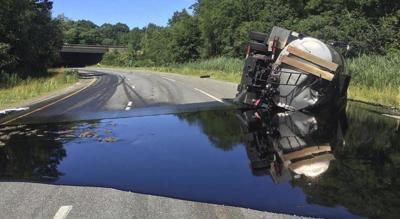 Interchange remains closed after asphalt truck crash