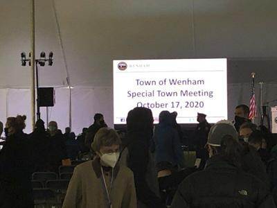 Under tents, residents turn out for town meetings