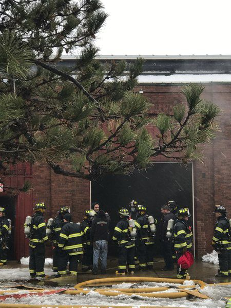 Firefighters chase stubborn roof fire in Pulaski Street mill