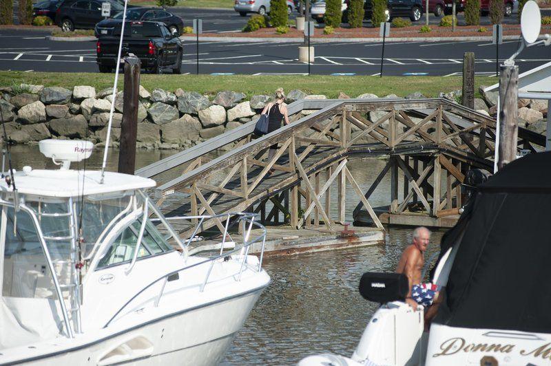 Neighbors, marina clash over free boat slips, temporary bridge