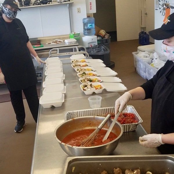 Root, Groom dish up emergency meals to service agencies