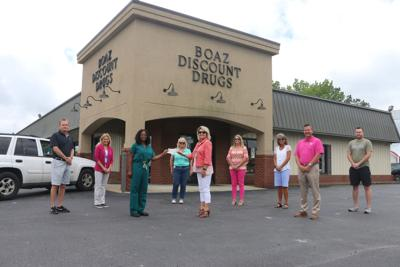 Rotary Club, Wilson's Screen Printing donates to Boaz Disaster Relief Fund