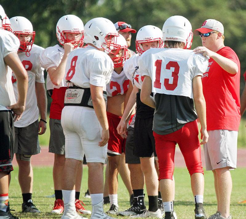 Baugh serving as assistant football coach